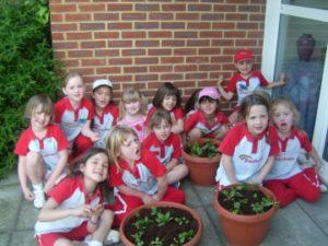 p_03_1st_Hogs_Back_Rainbows_planting_flowers_for_St_Josephs_school_ezg_2
