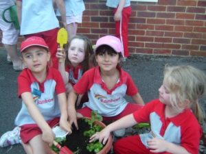 p_04_More_Rainbows_planting_flowers_for_St_Josephs_school_2_ezg_2